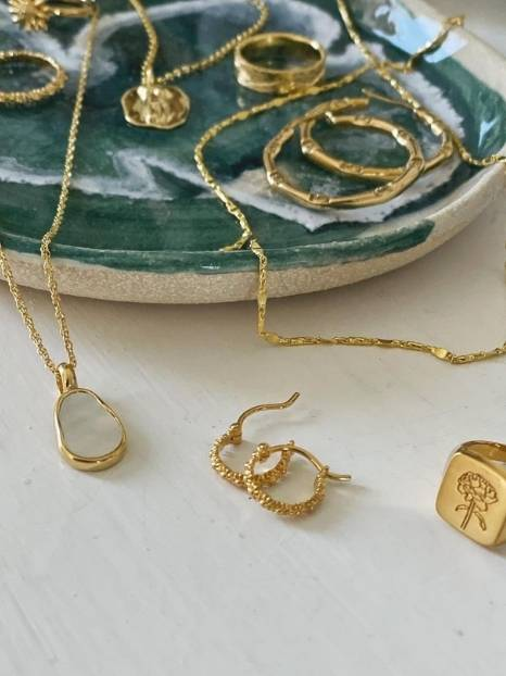 23 Ethically-made & sustainable jewelry brands to shine with purpose